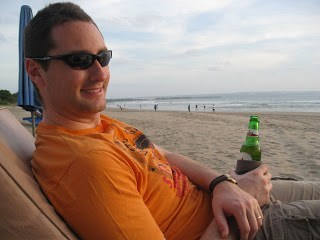 Sitting on beach in bali with a beer