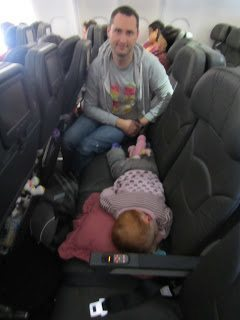Toddler asleep in jetstar flight