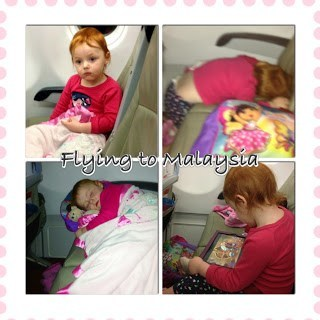 Toddler trying to sleep on an air asia flight