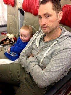 baby sitting on an air asia x flight melbourne to KL