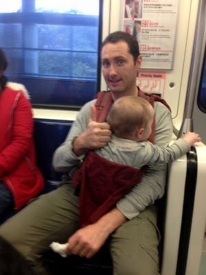 Riding the train in Taipei with kids - baby in ergo
