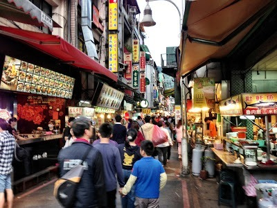 Busy Shilin night market eating in taipei