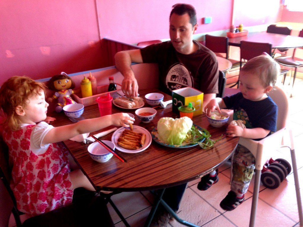 Family sitting with baby and toddler at thy thy vietnamese restaurant in victoria street richmond