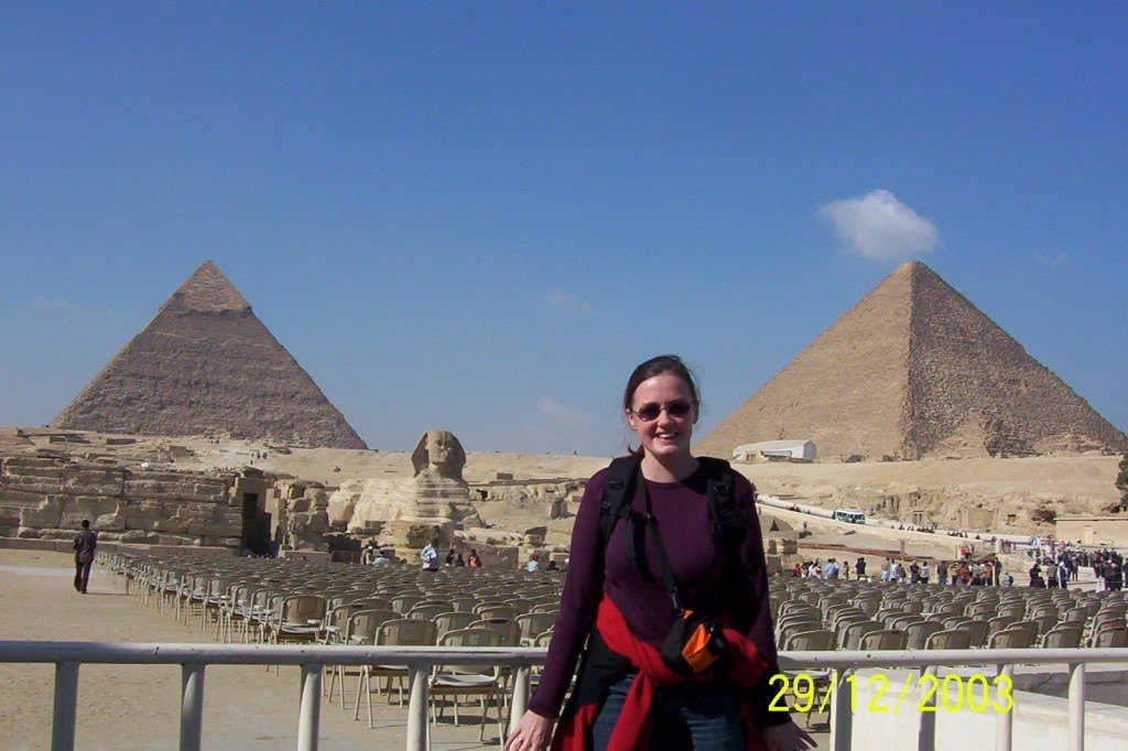 standing in front of the egyptian pyramids at Giza and the sphinx