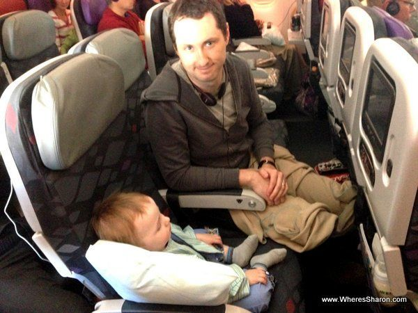 travelling with an infant on a plane sitting on a seat sleeping