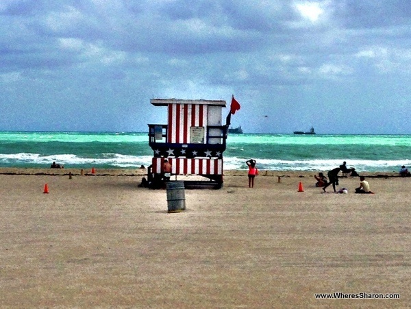 an american flag lifeguard station in south beach in miami beach