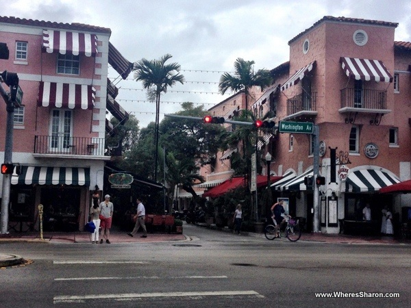 the beautiful, pink buildings at the entrance to Espanola Way, south beach miami
