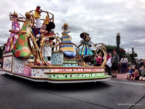 mickey and minnie mouse on a float at the disneyworld parade