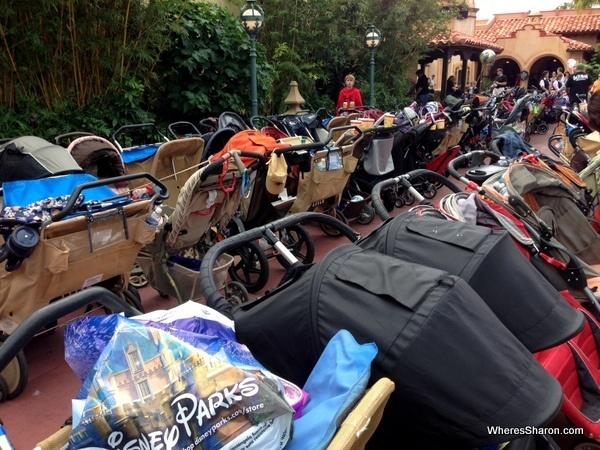 many strollers and prams in a stroller parking area in magic kingdom disneyworld