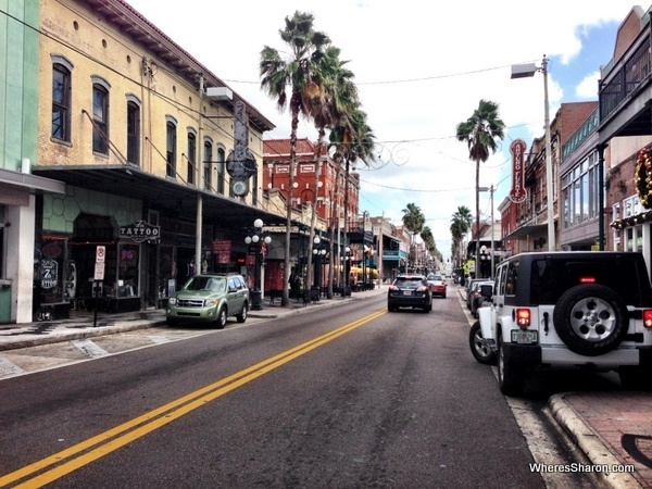 Shops, bars, cars and road in Ybor City