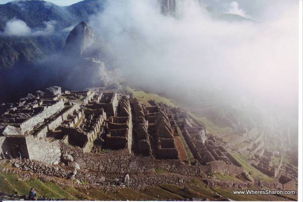 Macchu Picchu covered with some fog peru