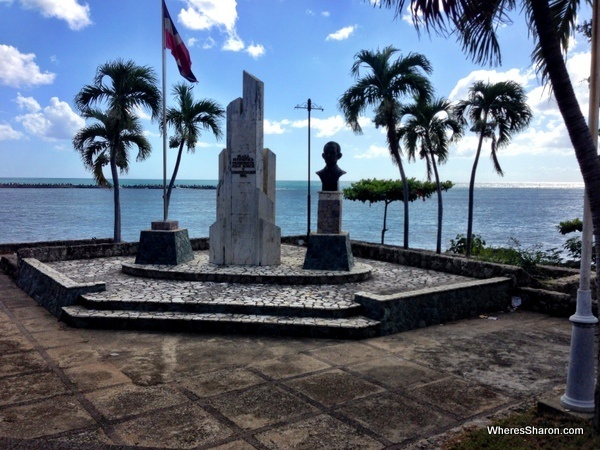 monument on the malecon with caribbean behind it