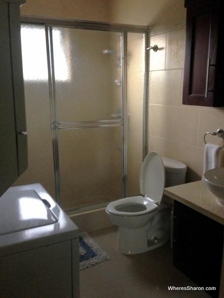 bathroom with washing machine and dryer cabarete