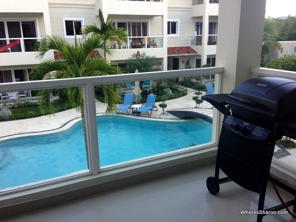 balcony with bbq and pool in the background in vacation rental cabarete