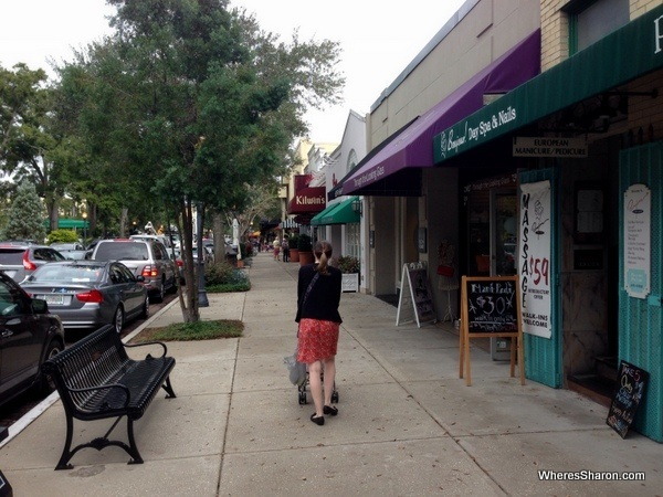 walking with a pram on the main street in winter park orlando