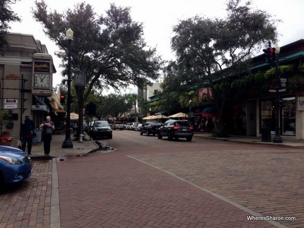 The street with cars trees and pretty buildings in Winter Park orlando