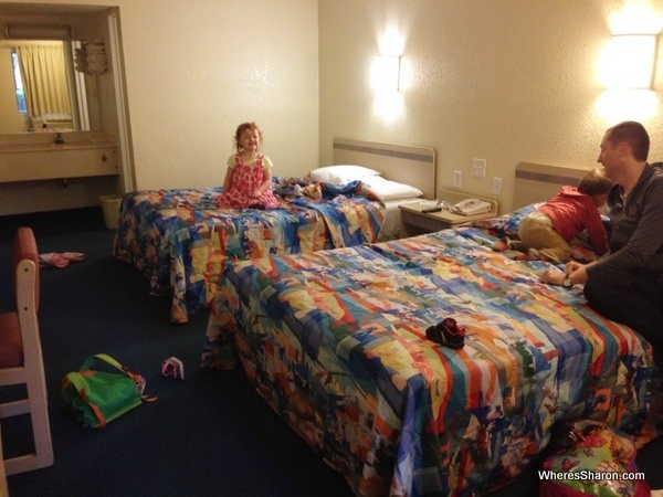 family sitting in beds in motel 6 tallahassee