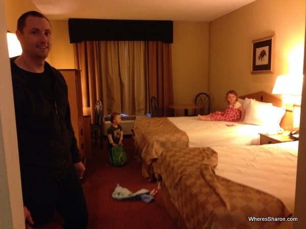 family on beds in Baymont Inn and Suites room motel chains USA