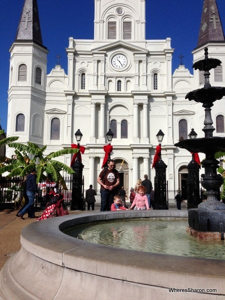 Family enjoying Jackson Square with St Louis Cathedral in the background