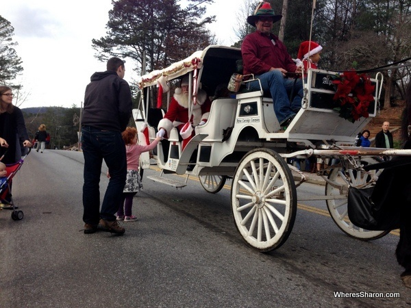 kid meeting santa on main street of Helen GA christmas parade