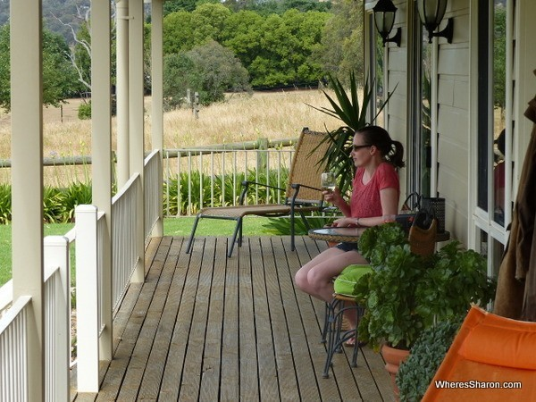 drinking wine on verandah at Airbnb Victoria farm stay