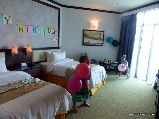 Our best welcome at a hotel ever - cake, balloons and a sign waiting in our room for Z's birthday
