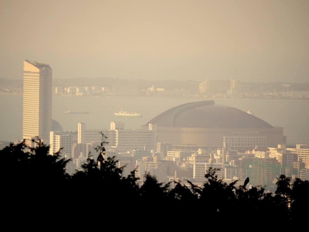 The famous Fukuoka Tower and Fukuoka Dome in the summer haze