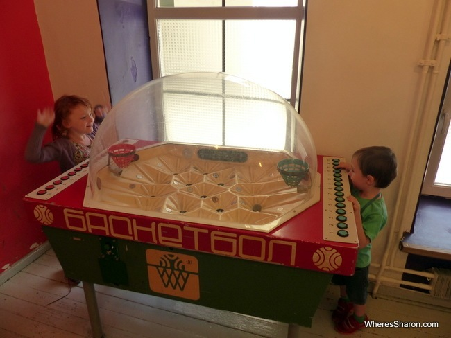 The kids playing it up, Communist style, on a basketball table.